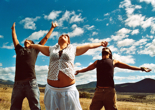 three people breathing relaxing fresh air
